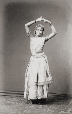 A nautch girl or dancer from southern India, posing in a studio, c. 1880..jpg